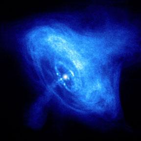 Une image dans les rayons X des jets de matière et d'antimatière qui s'éloignent de l'étoile à neutron au centre de la nébuleuse du Crabe. Cette image a été prise en 2002 par le satellite Chandra. L'anneau central a un diamètre d'environ une année-lumière. Crédit : NASA/CXC/ASU/J. Hester et al.