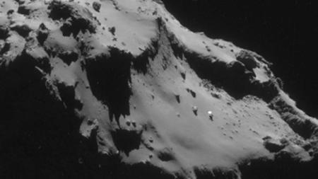 """Quelle est ce mystérieux point blanc à la surface de la comète """"Chury"""" ?Crédit:[ESA]"""